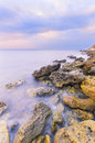 Bright sharp rocks in the water milky color Royalty Free Stock Image