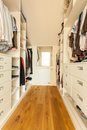 Bright spacious closet view of in modern house Royalty Free Stock Photography