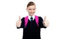 Bright student showing thumbs up sign Royalty Free Stock Photo