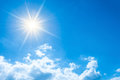 Bright sun on blue sky Royalty Free Stock Photo