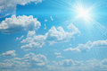 Bright sun on blue sky clouds backrounds Royalty Free Stock Photo