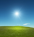 Bright sunny meadow sparse clouds Royalty Free Stock Photo
