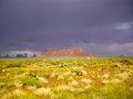 Bright sunshine and rainbow after the storm desert over monument valley utah Stock Photos