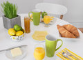 Bright table setting with tasty breakfast and healthy Royalty Free Stock Images