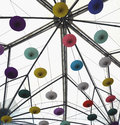 Bright white ceiling with colorful upside down umbrella decorations Royalty Free Stock Photo