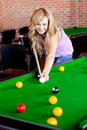 Bright woman playing pool Stock Photo