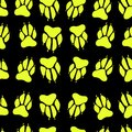 Bright yellow color paw print dog imprint seamless pattern, blac Royalty Free Stock Photo