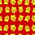 Bright yellow color paw print dog imprint seamless pattern, red Royalty Free Stock Photo