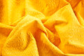Bright yellow cotton fabric abstract background of scrunched up Royalty Free Stock Image