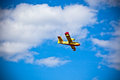 Bright Yellow Firefighter Plane in a Blue Sky Stock Photo