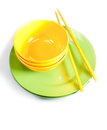 Bright yellow and green plates with chopsticks empty Royalty Free Stock Images