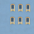 Bright Yellow Windows on Blue Stock Photo
