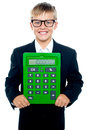 Bright young kid holding large green calculator Royalty Free Stock Photo