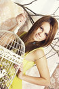 Bright young pretty woman posing cage suitcase Royalty Free Stock Photos
