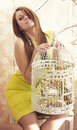 Bright young pretty woman posing cage suitcase Stock Images