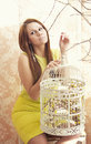 Bright young pretty woman posing cage suitcase Stock Photos