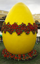 Brightly colored easter egg with flowers sits in the center of an Easter market in Vienna, Austria