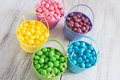 Brightly colored jelly beans for easter from above in baskets Royalty Free Stock Photo