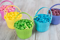 Brightly colored jelly beans for easter in baskets Royalty Free Stock Images
