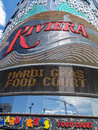Brightly colored promotional facade of Riviera Hotel and Casino