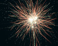 Brightly colorful explosive fireworks light up the night sky at New Year`s eve celebrations. Happy New Year 2017 and holidays