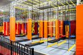 Brightly coloured interior ninja warrior parkour gym obstacle course with aerial netting Royalty Free Stock Photo