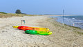 Brightly coloured pedalos Studland knoll beach Dorset England UK Royalty Free Stock Photo