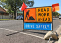 Brightly coloured road work ahead signs Royalty Free Stock Photo