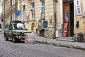 Brightly decorated car advertizes an input in art gallery in the old city on june in tallinn estonia Royalty Free Stock Images