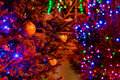 Brightly illuminated xmas trees in the dark street glass balls colorful lights reflections red and orange hue blue and green Stock Images