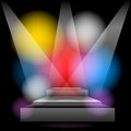 Brightly lit stage podium with colored lights Royalty Free Stock Photos