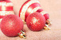 Brightly red christmas decorations on the background Stock Photography