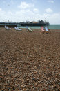 Brighton beach deckchairs palace pier Stock Photo