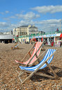 Brighton England - Deck chairs on Brighton Beach. Royalty Free Stock Image