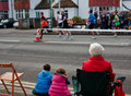 Brighton and hove marathon two childre a senior woman watching the april in england Stock Photography