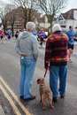Brighton and hove marathon two senior men a dog watching the april in england Royalty Free Stock Photos
