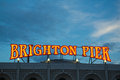 Brighton pier lights england illuminated sign at the entrance to the taken in the evening Stock Photography
