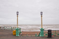Brighton promenade with lamppost in rainy day.