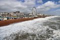 Brighton seafront view of wheel from the pier Royalty Free Stock Image