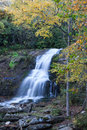 Brilliant fall foliage surrounds soft flowing waterfall in nc Royalty Free Stock Photo