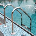 Brilliant hand rail leaders in pool on open air Royalty Free Stock Photo