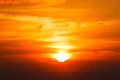 Brilliant orange sunrise over clouds in iowa with bright yellow sun Stock Image