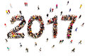 Bringing in the new year. Large group of people in the shape of 2017 celebrating a new year , or future goals and growth concept o
