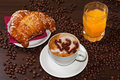 Brioches e cappuccino and juice Royalty Free Stock Photos