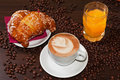 Brioches e cappuccino and juice Royalty Free Stock Images