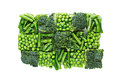 Briquette of assortment fresh frozen green peas, french bean, broccoli with hoarfrost closeup on white background. Royalty Free Stock Photo