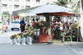 Brisk posy trade at city street cluj mapoca romania — september woman sales flowers on the on september in cluj napoca romania Royalty Free Stock Photography