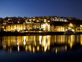Bristol docks at nighttime the in uk with a floating wine bar and houses Royalty Free Stock Photo