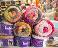 Bristol, UK - February 12 2020: Balls of colourful knitting Stylecraft wool piled up in the window of a wool and craft shop Royalty Free Stock Photo