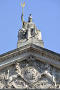 Britannia statue and trident with coat of arms below at roof level on somerset house london Royalty Free Stock Images